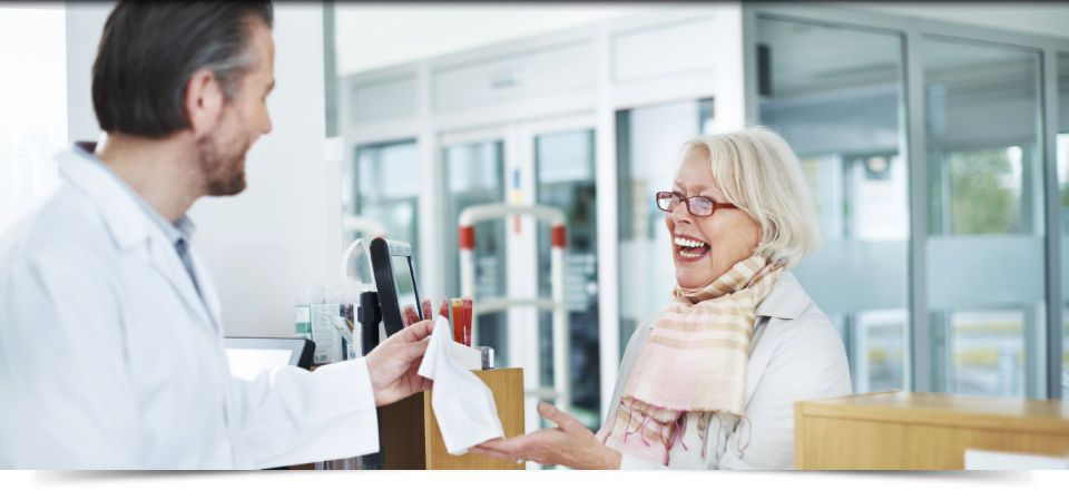 Pharmacist with Smiling Senior